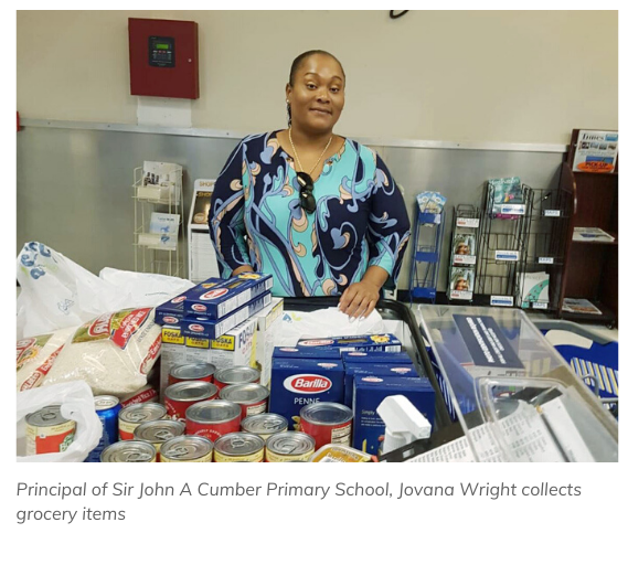 Principal Jovana Wright collects grocery items