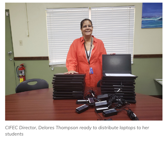 CIFEC Director, Delores Thompson is ready to distribute laptops to students
